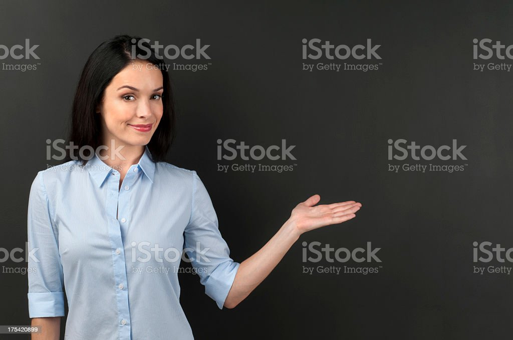 Woman presenting something on a blackboard stock photo