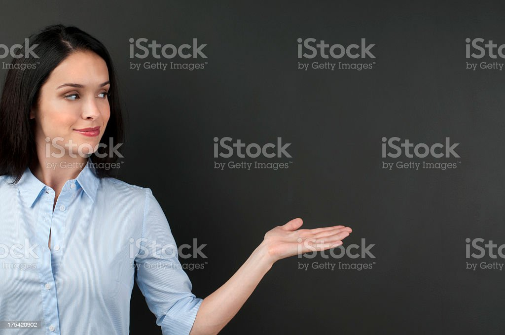 Woman presenting something on a blackboard royalty-free stock photo