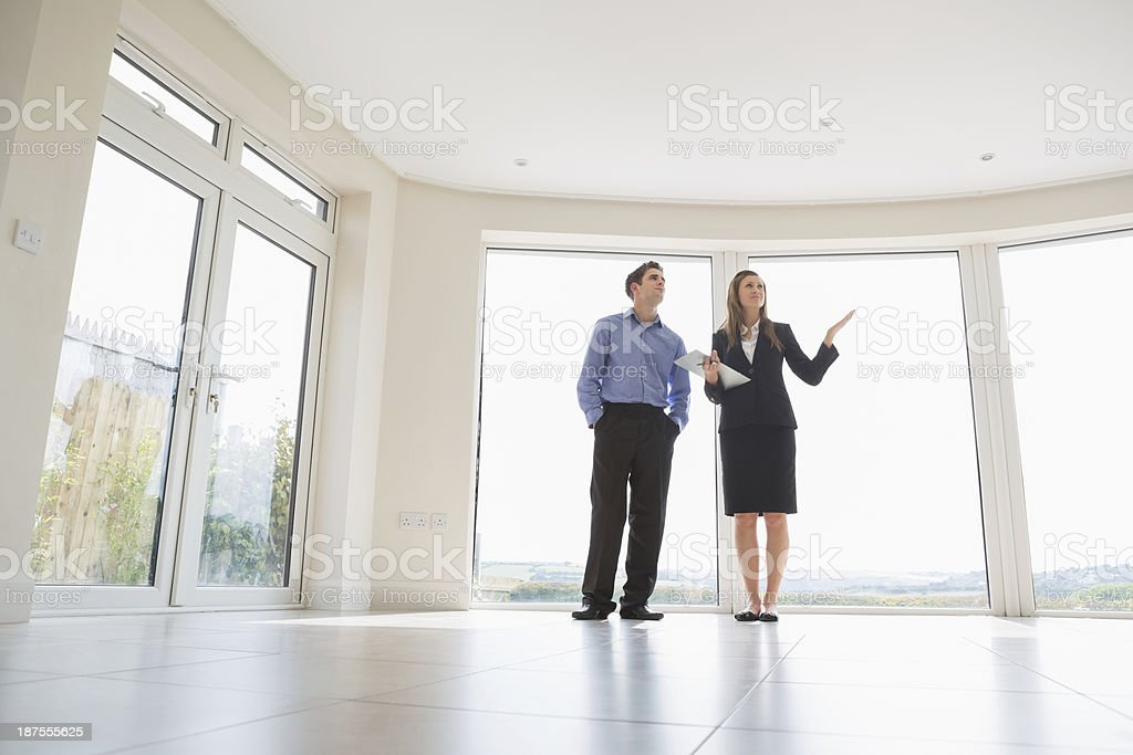Woman presenting the rooms stock photo