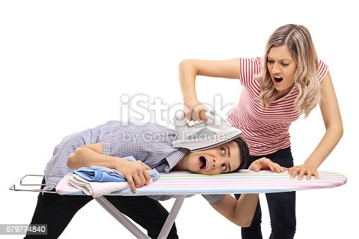 494388938istockphoto Woman pressing a man with an iron 579774840