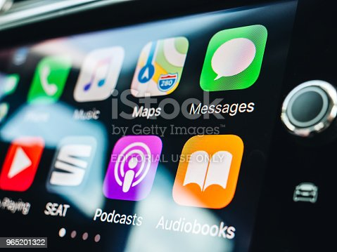 istock Woman pressing button on the Apple CarPlay 965201322