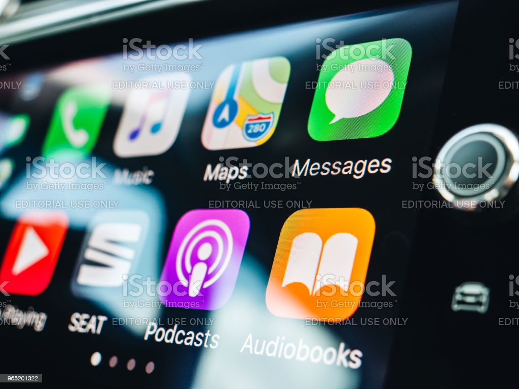 Woman pressing button on the Apple CarPlay stock photo