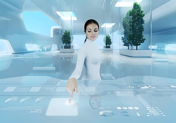 woman pressing virtual button in futuristic office - 虛擬辦公室 個照片及圖片檔