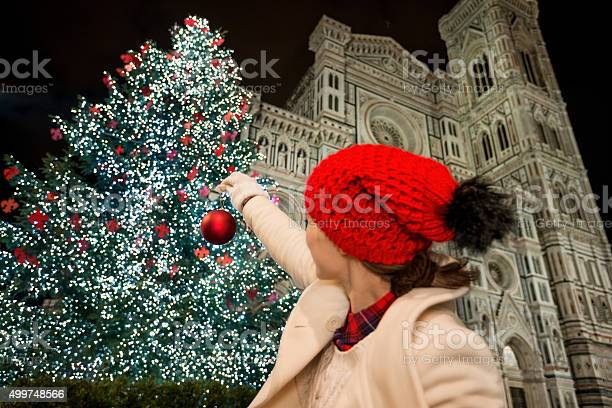 Woman pretend decorating christmas tree in florence italy picture id499748566?b=1&k=6&m=499748566&s=612x612&h=o80peazrkwgyjh2bmmwnt0xvuvgydmxpvji61qji qo=