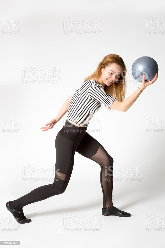 woman pretending to be a statue of discus thrower stock photo