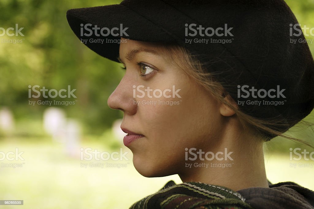 Woman profile portrait with cap royalty-free stock photo