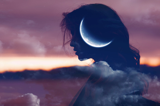Beautiful woman profile silhouette portrait with moon in her head.