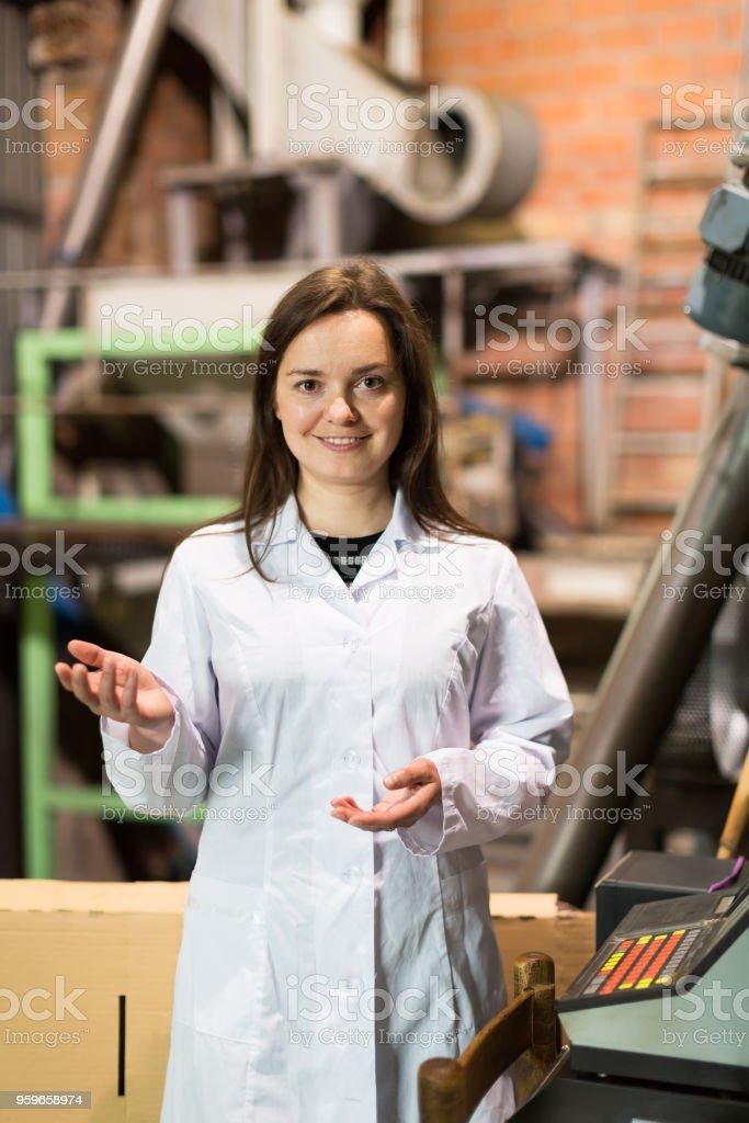 Woman programming process inside factory stock photo