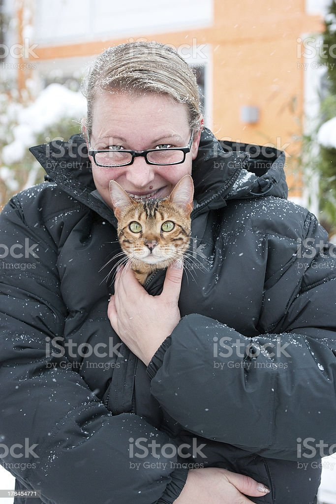 Woman protecting Cat from cold Weather stock photo