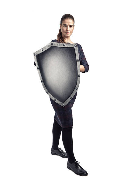 Woman protecting herself with a shield stock photo