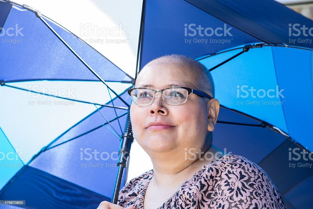 Woman Protects Skin From Sun stock photo