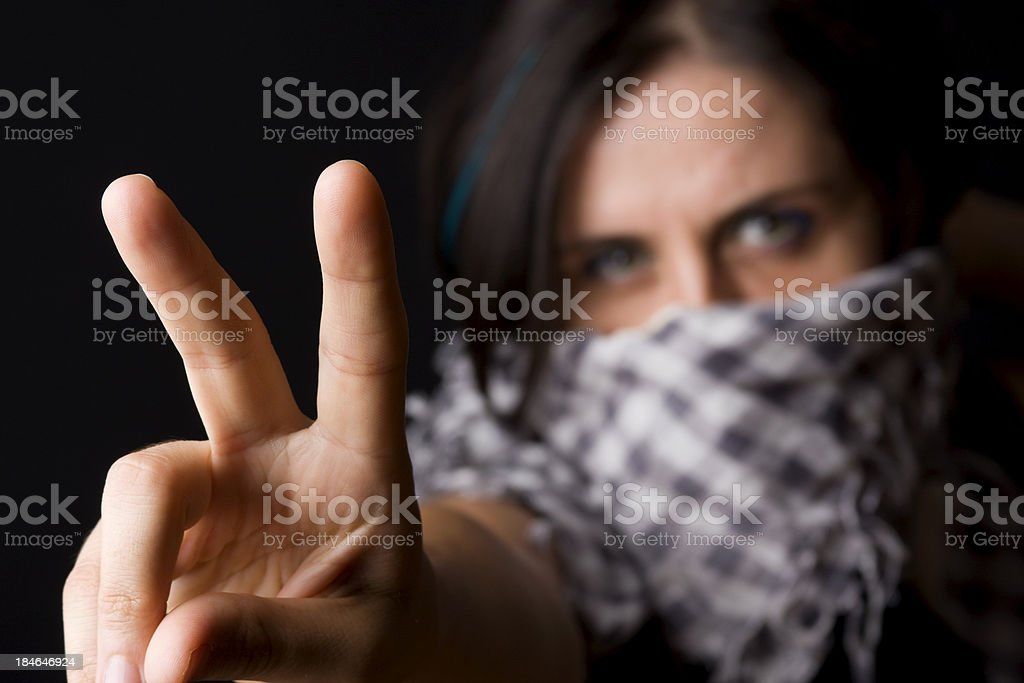Woman protestor showing peace sign stock photo