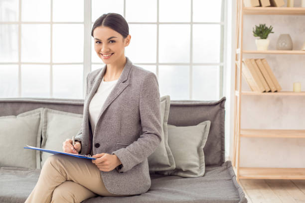 Woman psychologist specialist professional doctor in the office stock photo