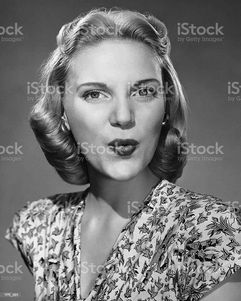 Woman puckering lips royalty-free stock photo