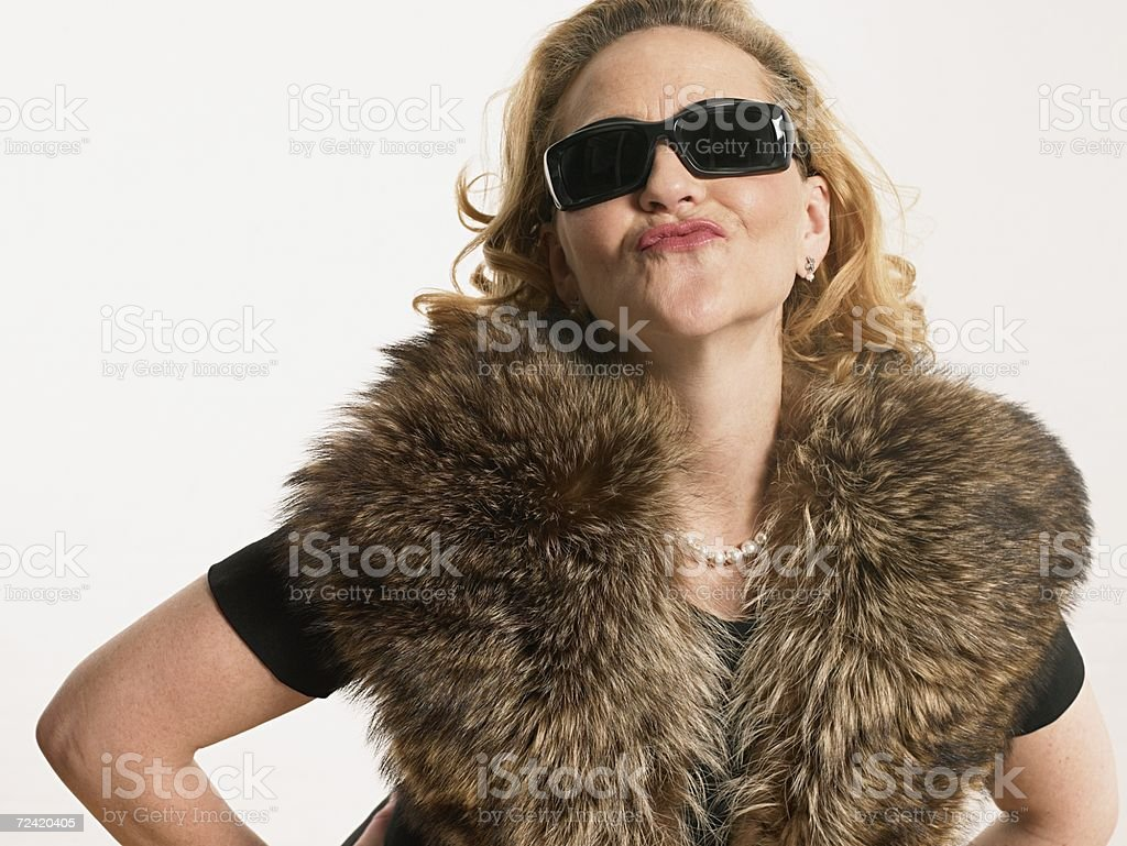 Woman puckering royalty-free stock photo