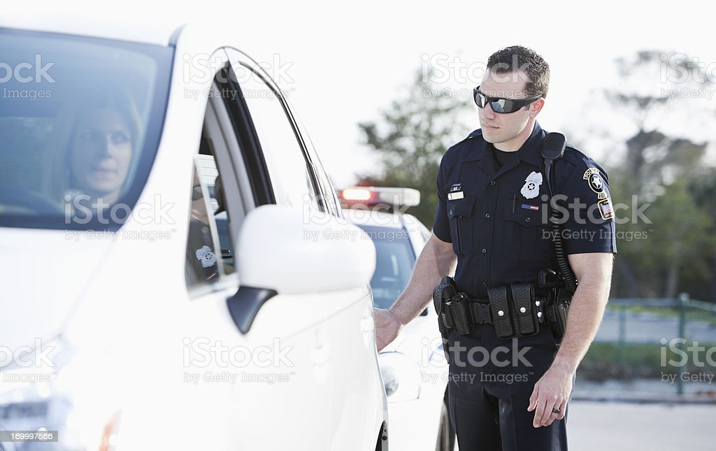 Woman pulled over by police royalty-free stock photo