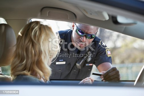 Woman driving car, pulled over by African American police officer (20s).
