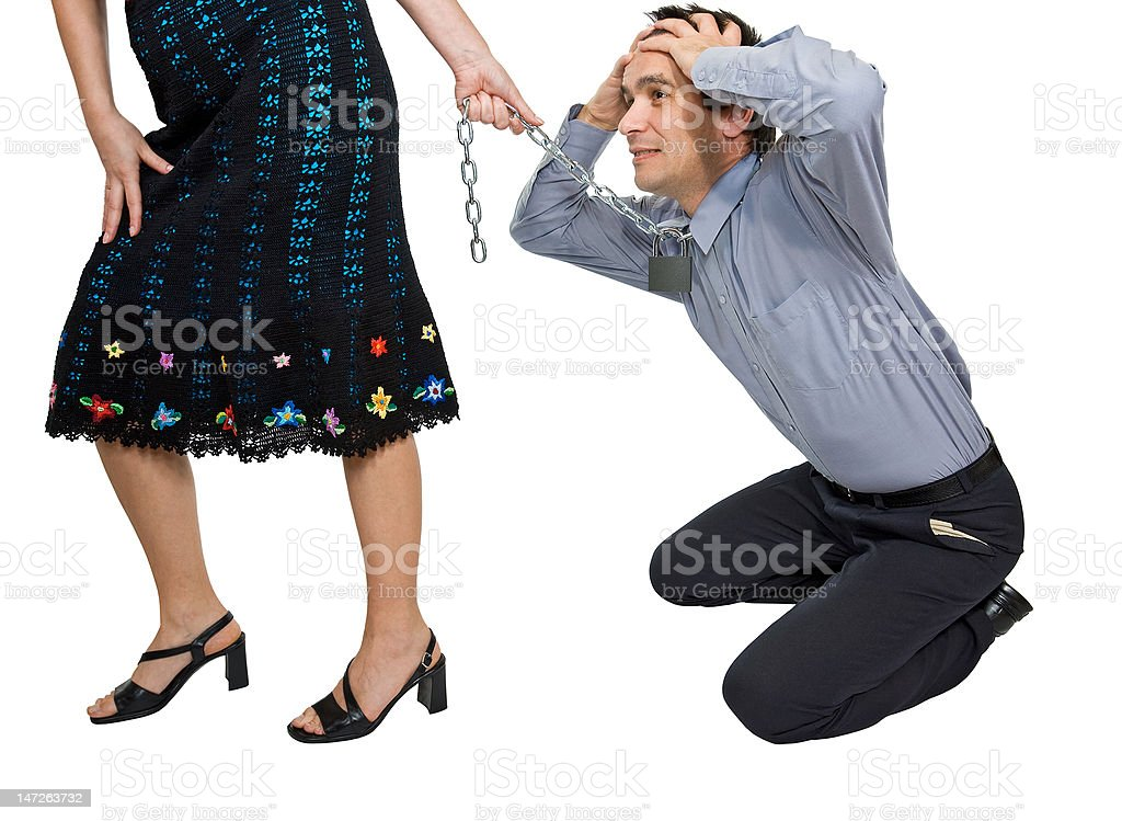 Woman pulling a businessman stock photo