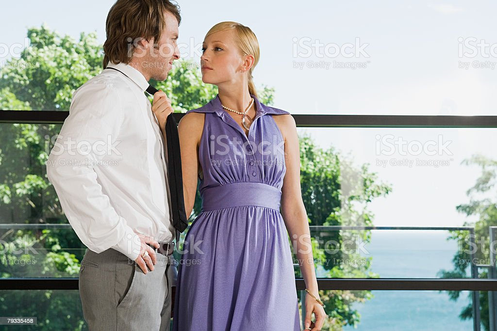 A woman pulling a mans tie 免版稅 stock photo