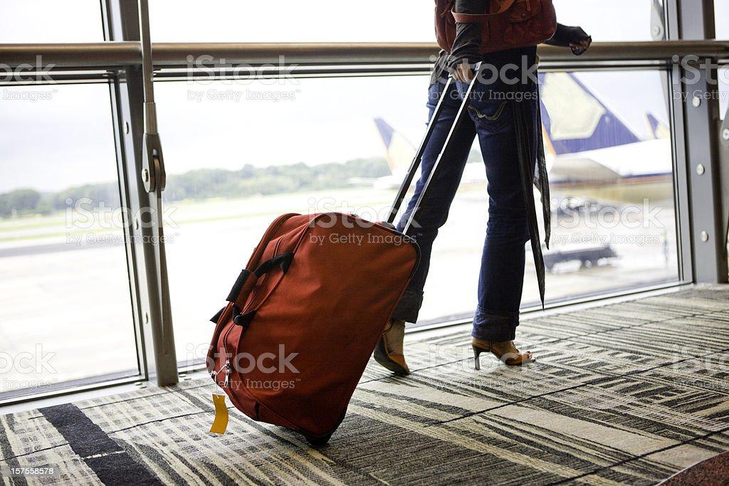 Woman pulling luggage stock photo