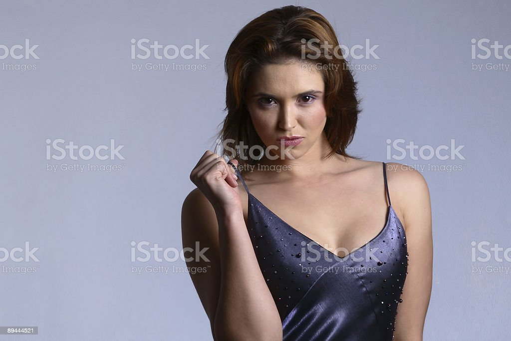 Woman pulling off dress royalty-free stock photo