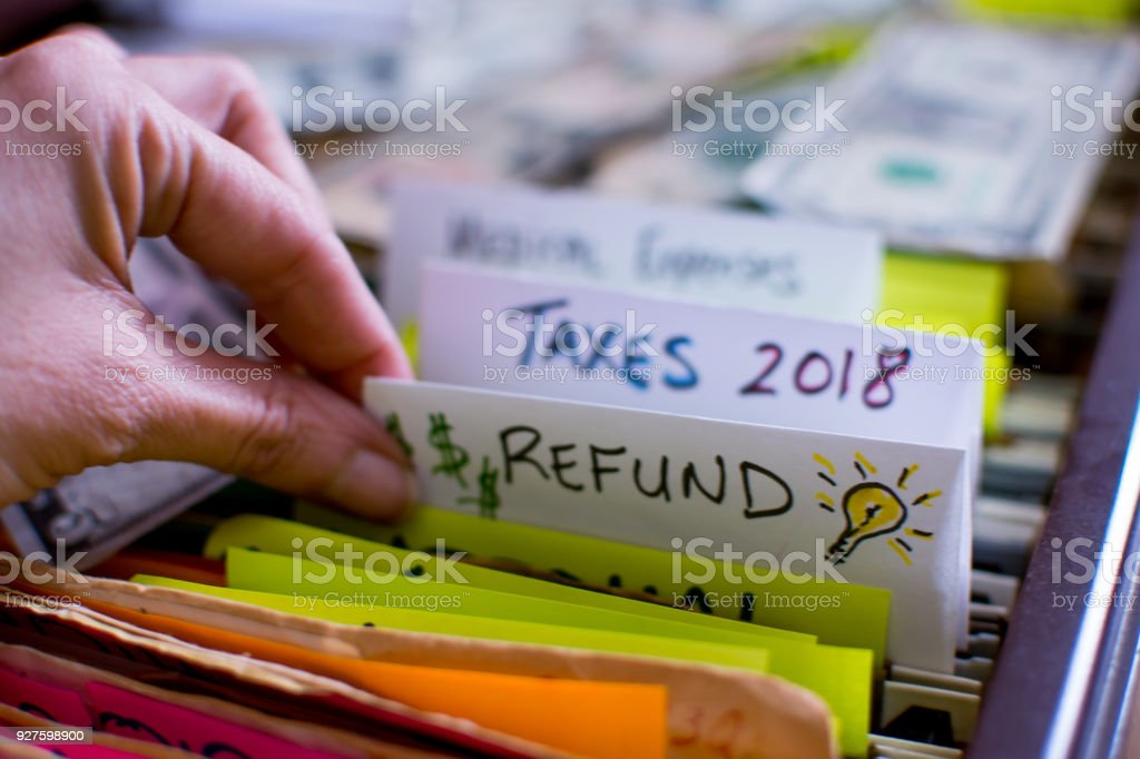 Woman pulling out file on Tax season 2018 Tax refund stock photo