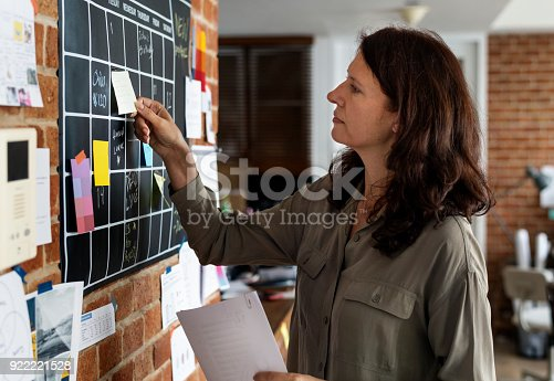 istock Woman pulling sticky note 922221528