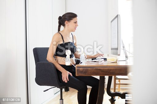 Woman pumping breast milk at work