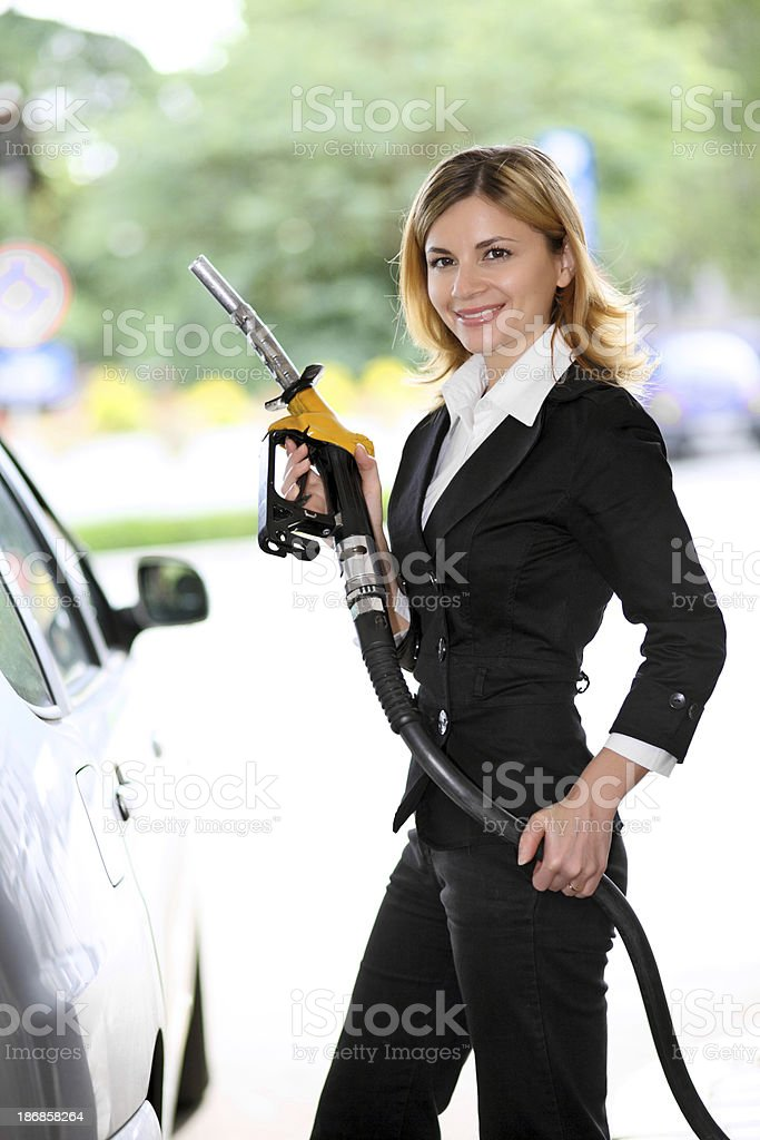 Woman pumping gas in gas-station. royalty-free stock photo