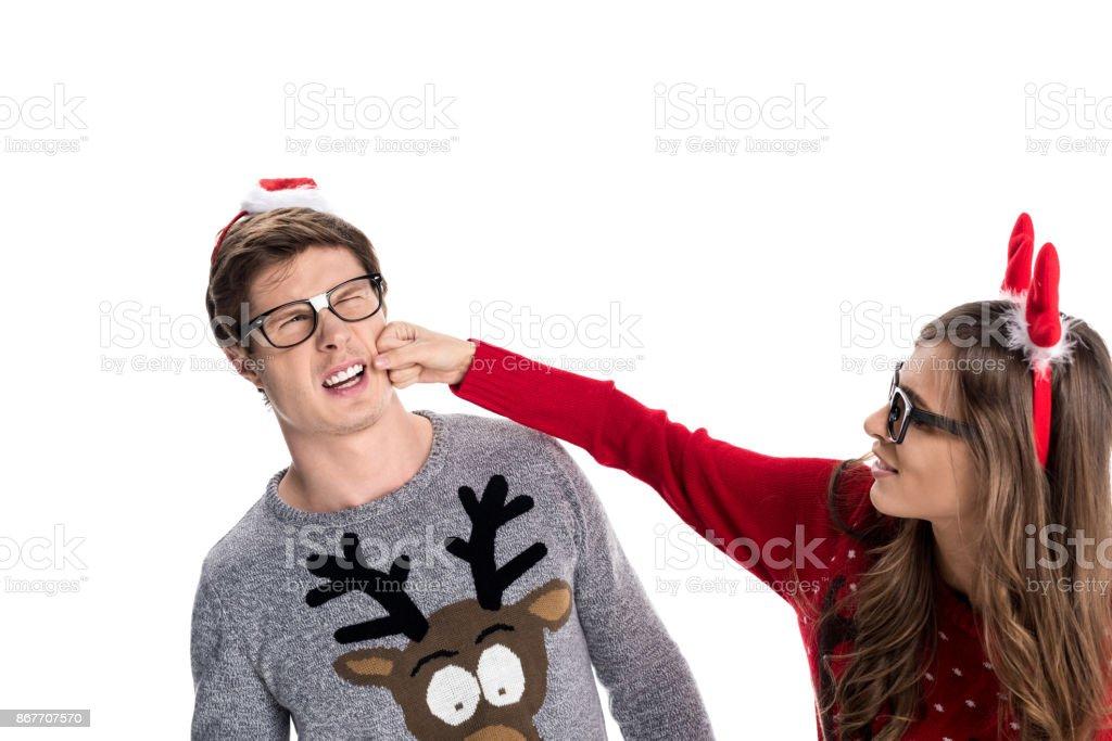 woman punching boyfriend stock photo