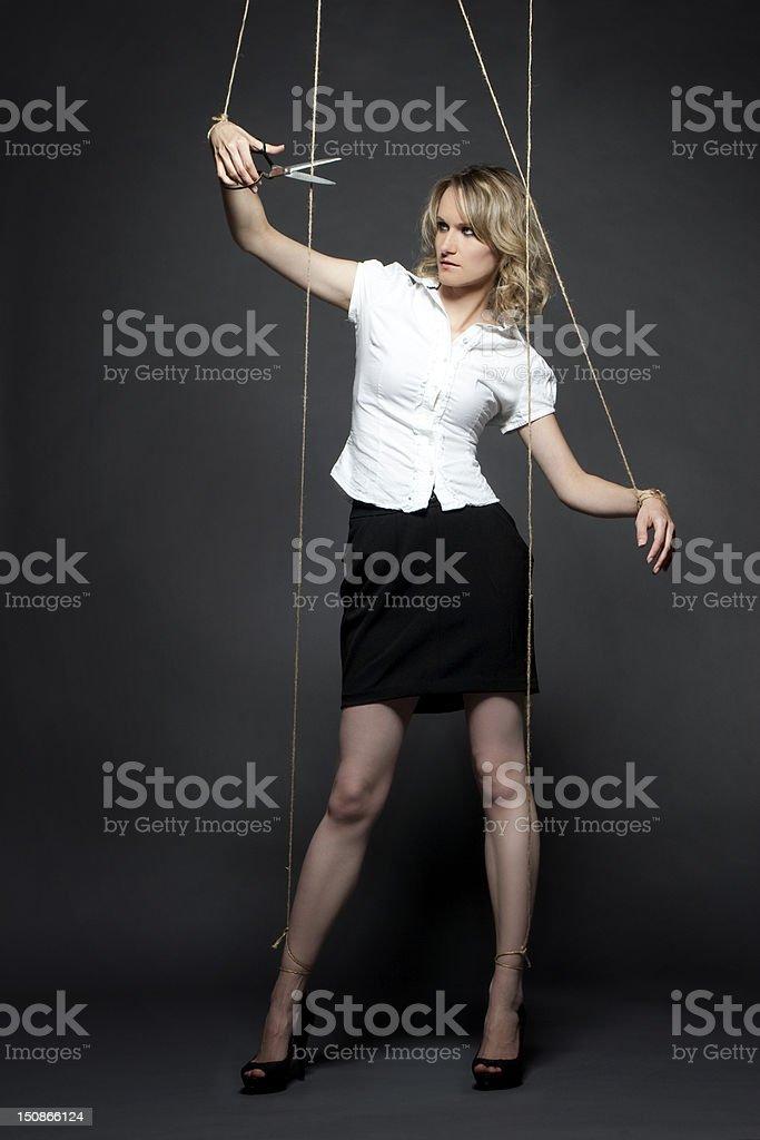 woman puppet manipulation cut rope scissors royalty-free stock photo
