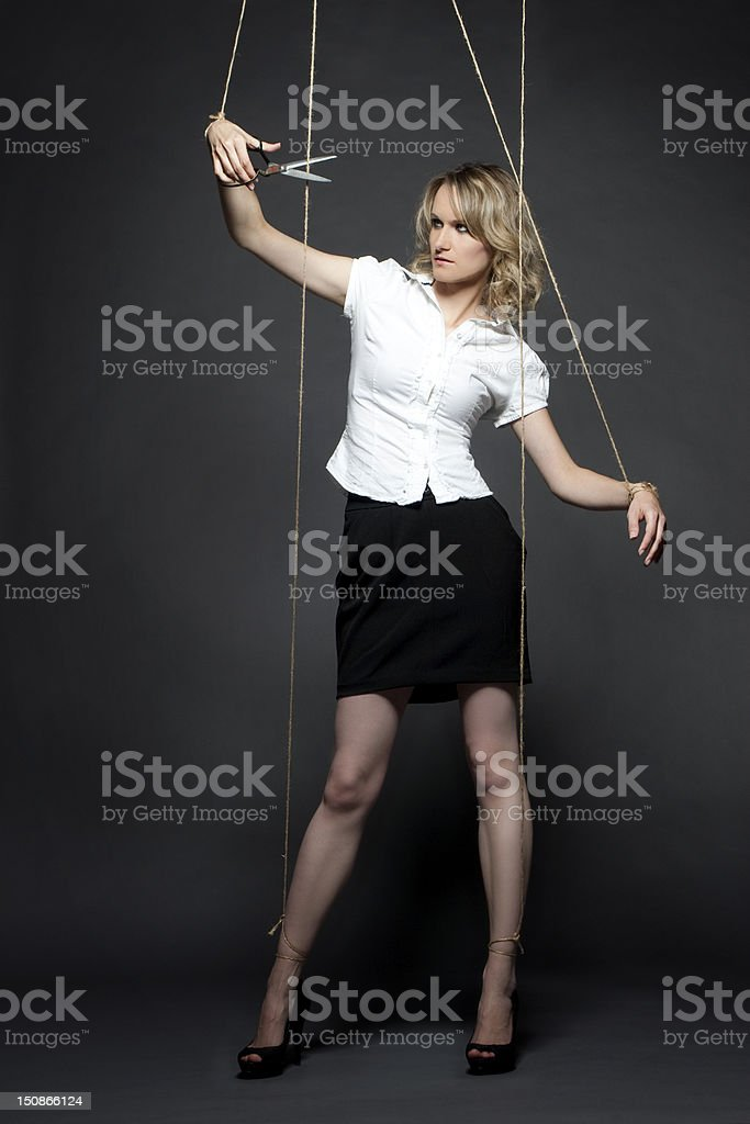 woman puppet manipulation cut rope scissors stock photo