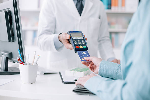 Woman purchasing medical products bildbanksfoto
