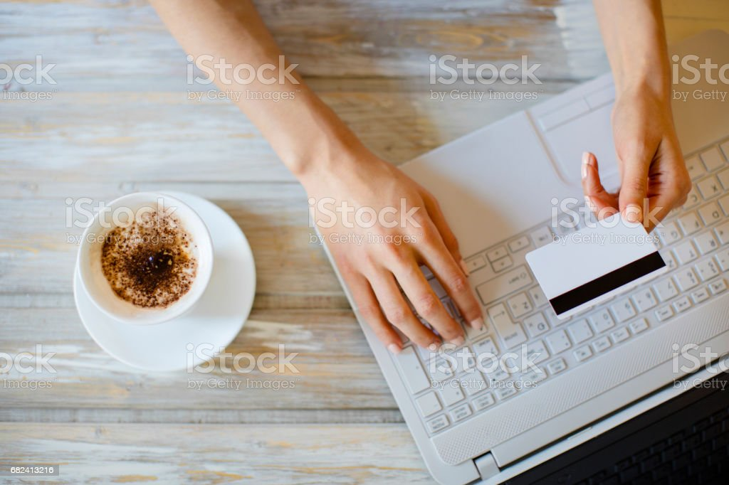 Woman purchasing online and drinking coffee close up royalty-free stock photo