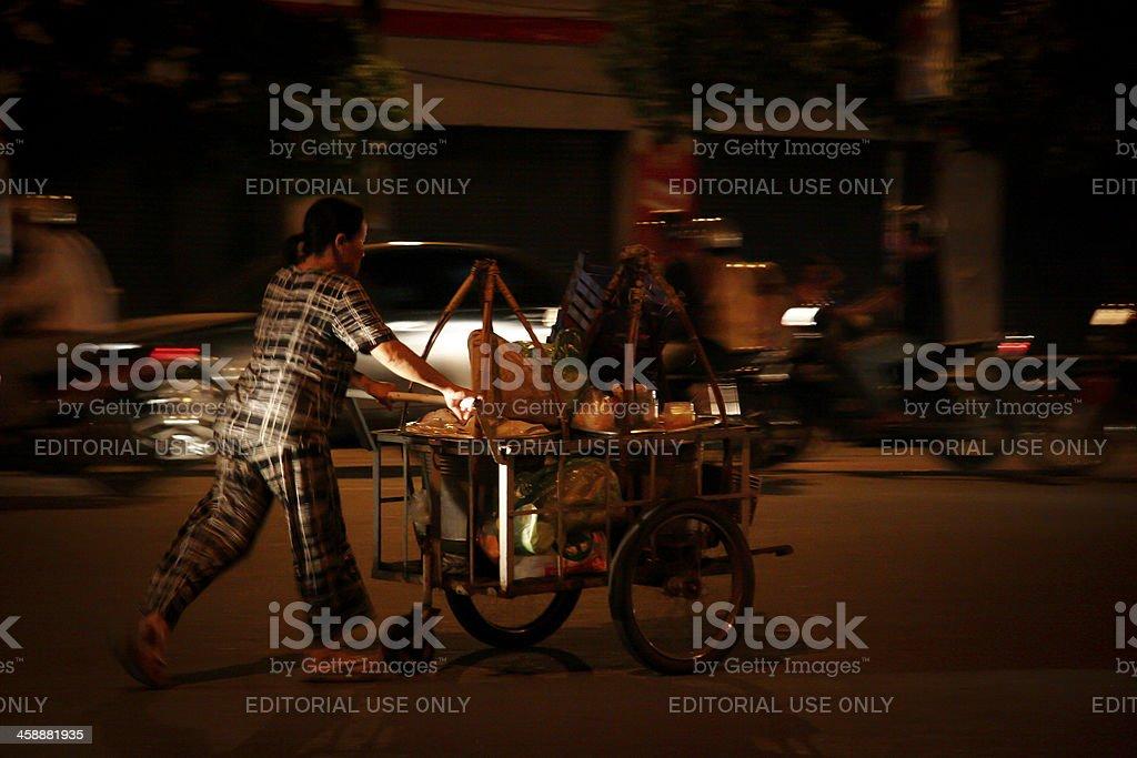 woman push vendor on the street royalty-free stock photo