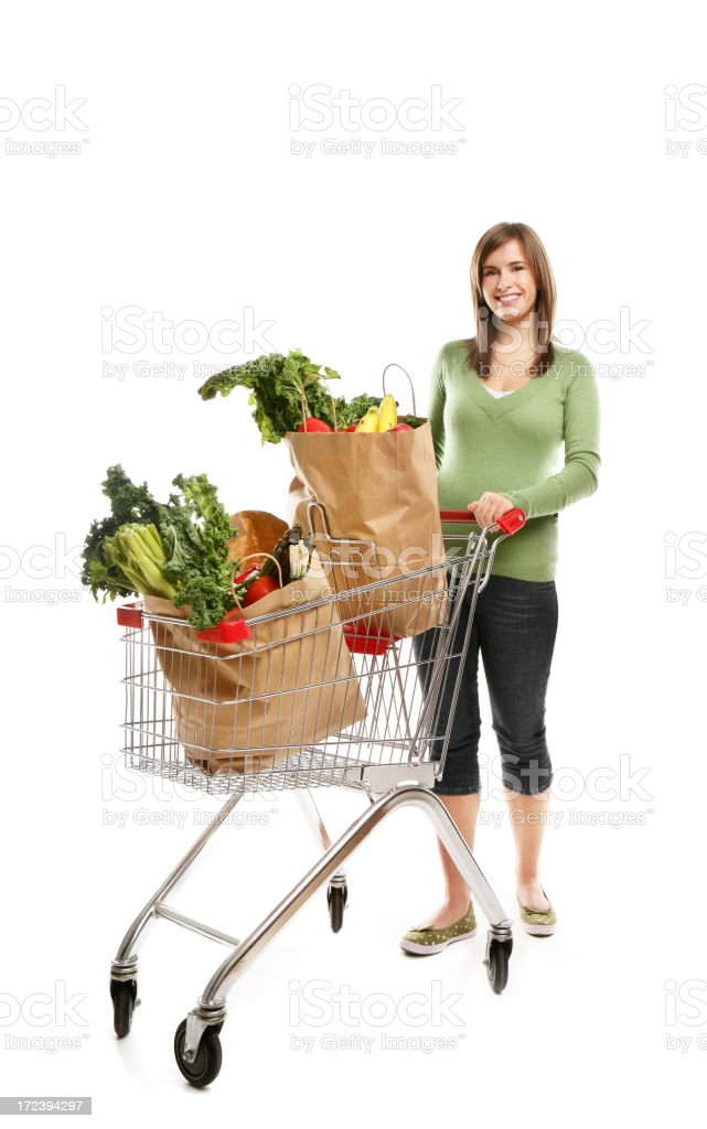 Woman pushing a shopping cart containing grocery royalty-free stock photo