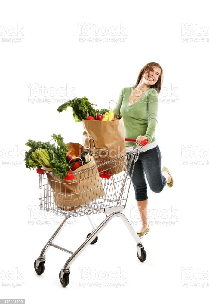 Woman pushing a shopping cart royalty-free stock photo