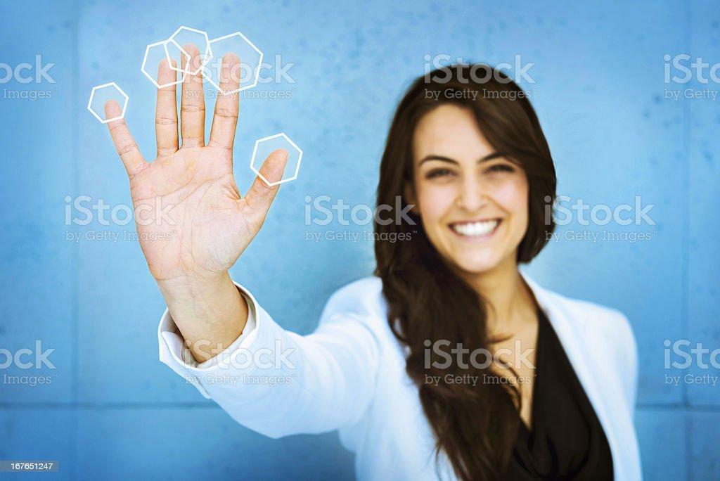 Woman pushing digital interface royalty-free stock photo