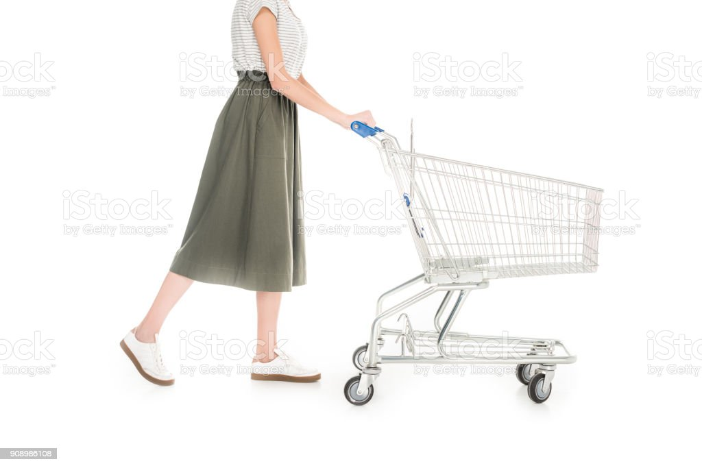 woman pushing empty shopping trolley isolated on white stock photo