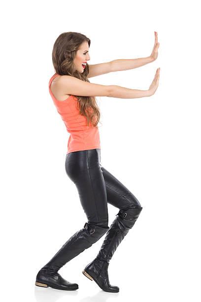 Woman Pushing Imaginary Wall stock photo