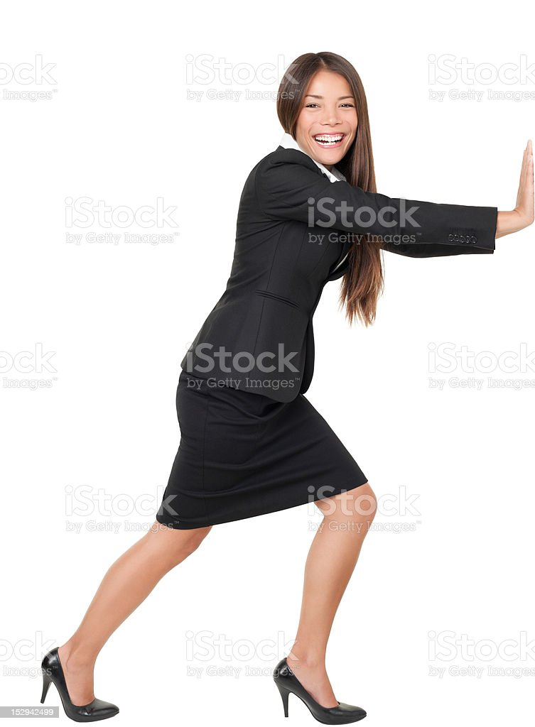 Woman pushing / leaning on wall stock photo
