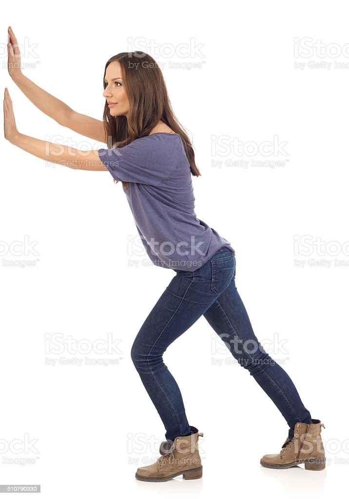 Woman pushing stock photo
