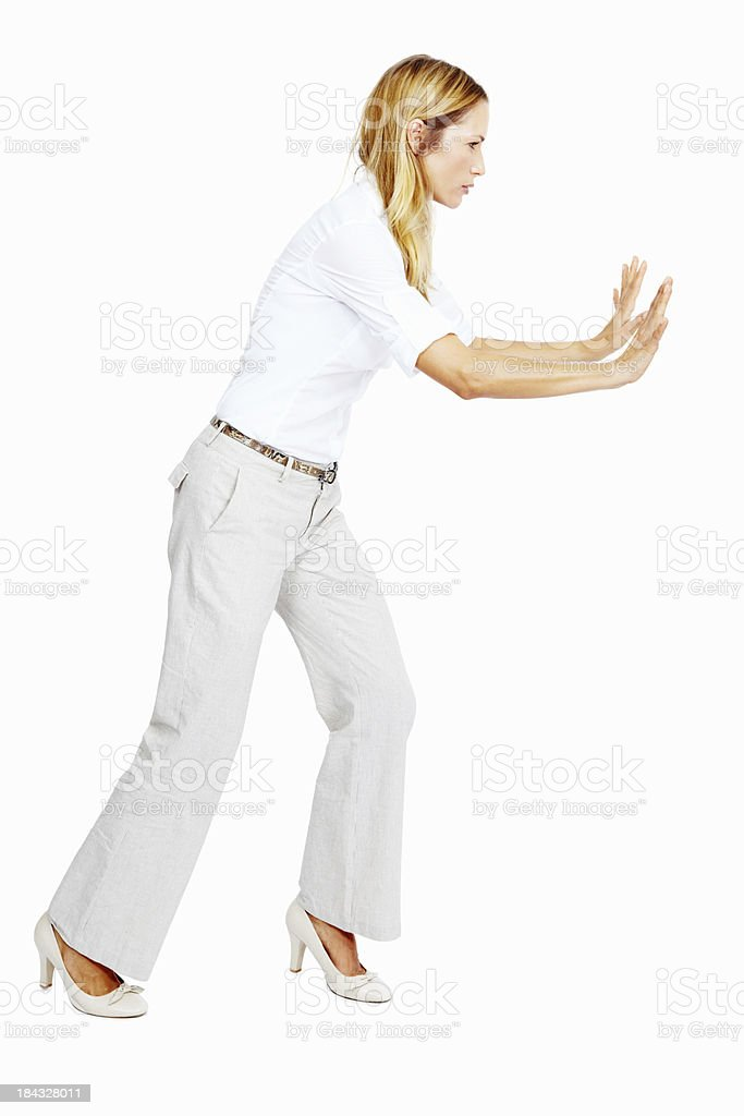 Woman pushing something stock photo
