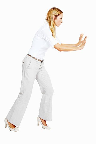 Woman pushing something stock photo
