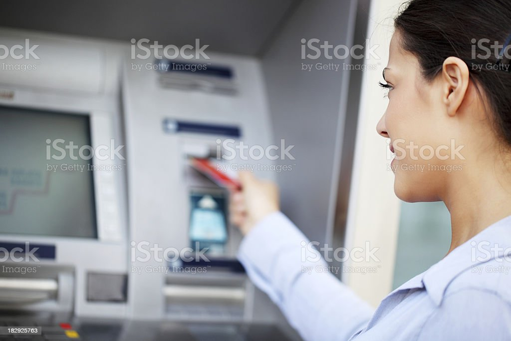 Woman put her credit card at the ATM. royalty-free stock photo