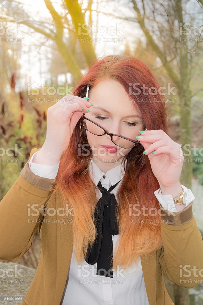 Woman puts glasses on stock photo