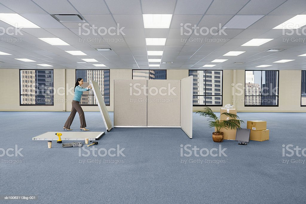 Woman putting cubicle together royalty-free stock photo