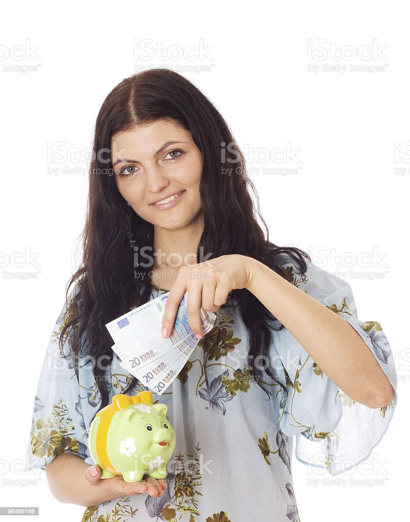 Woman putting euro in piggy bank. royalty-free stock photo