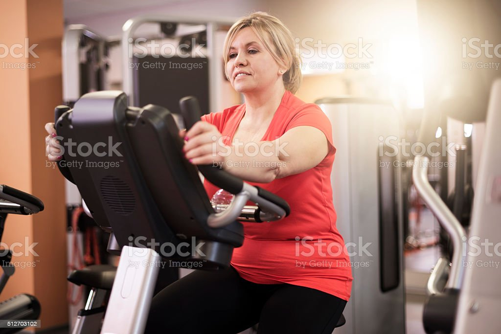 Woman putting great effort into exercising