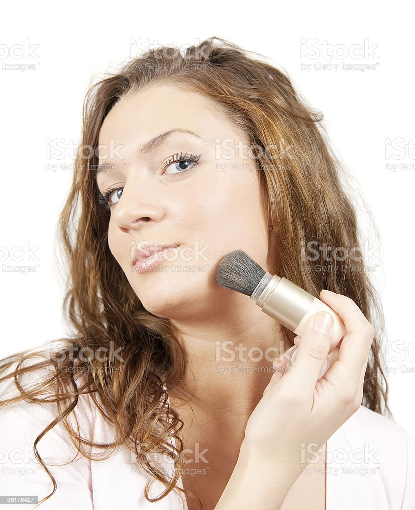 woman putting make up on her face royalty-free stock photo